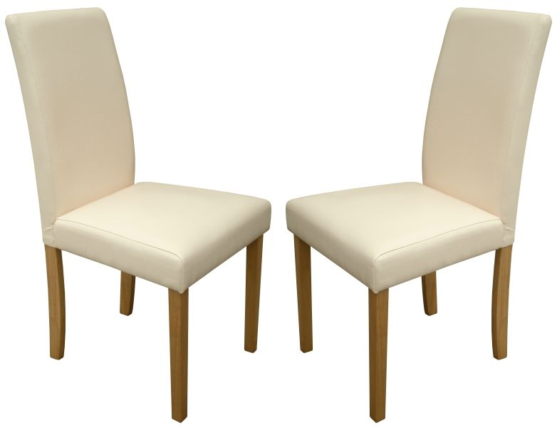 Torino cream faux leather dining chairs 1 2 price sale now for Cream dining room chairs sale